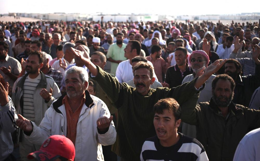 Syrian refugees chant slogans against Syrian President Bashar Assad at Zaatari Syrian refugee camp in Mafraq, Jordan, Thursday, Aug. 8, 2013. (Mohammad Hannon/AP)