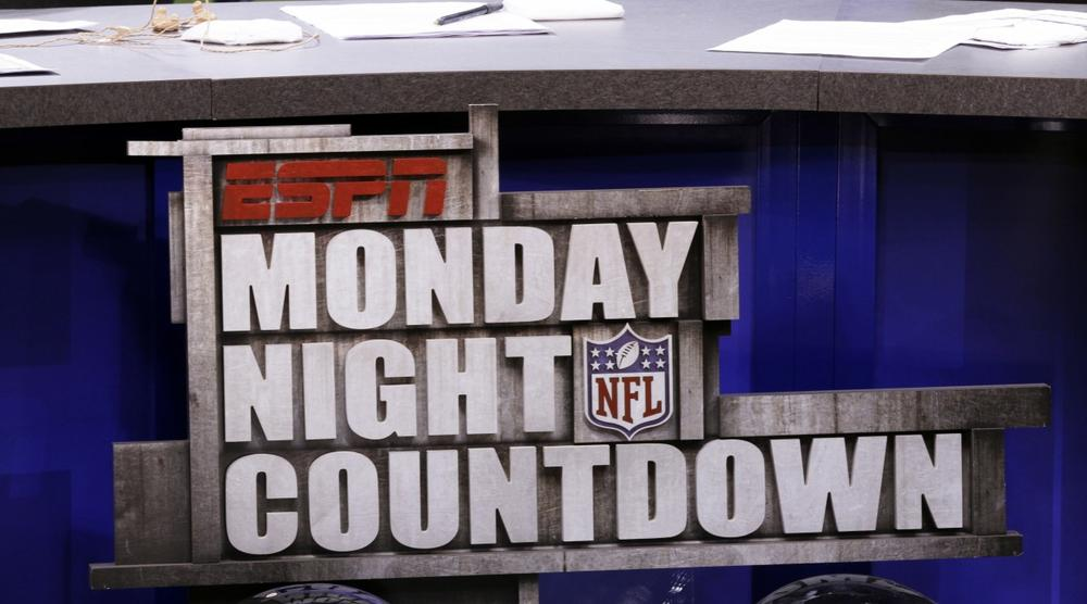 Some are questioning the relationship between the NFL and ESPN, which broadcasts games and produces much of the industry's hard hitting journalism. (David J. Phillip/AP)