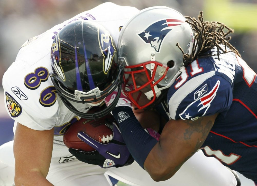 The $765 million settlement will provide relief to former NFL players who suffered too many hits like this one between Todd Heap, left, and Brandon Meriweather from 2010. (Winslow Townson/AP)