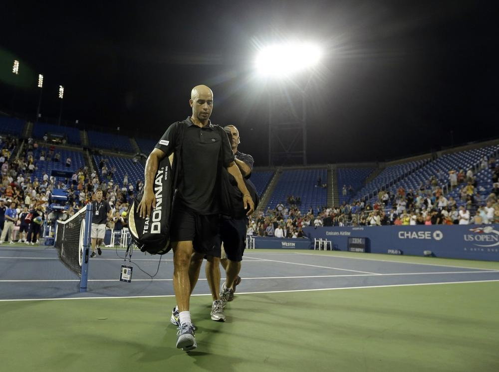 American James Blake, who recently announced his retirement, walks off the court following his loss at the U.S. Open. (Darron Cummings/AP)