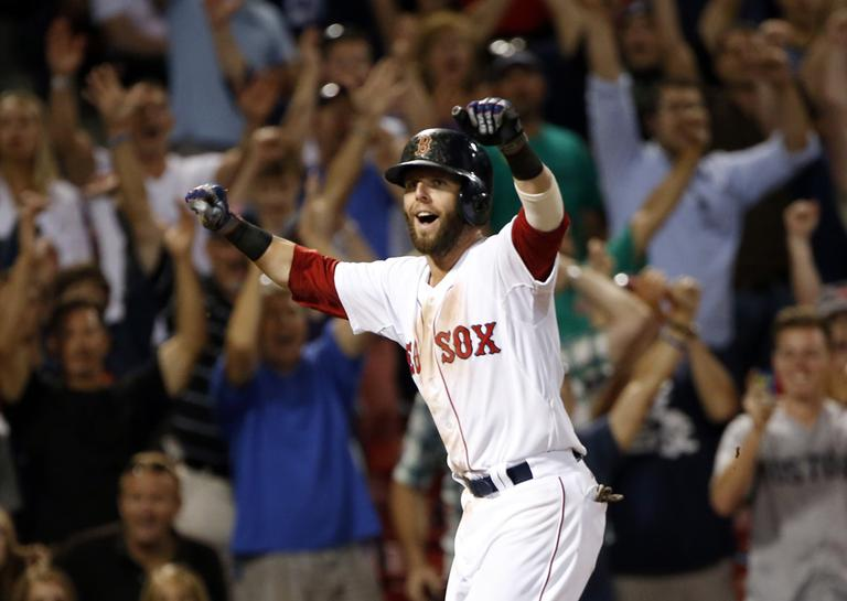Dustin Pedroia celebrates as he scores the winning run on a single by Stephen Drew in the 15th inning against the Seattle Mariners. (AP)
