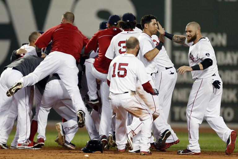 The Red Sox including celebrate after a walkoff-single by Daniel Nava that scored Dustin Pedroia in the ninth inning. (AP)