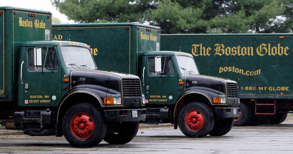 Boston Globe delivery trucks sit parked at their printing plant in Billerica, Mass. (Charles Krupa/AP)