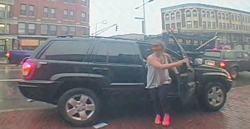 In this surveillance photograph made available by the Boston Police Department, Amy Lord, a 24-year-old woman from the South Boston neighborhood, steps out of a Jeep on Tuesday morning July 23, 2013, in Boston. Lord was found stabbed to death in a Boston park after she was abducted and taken to several banks to withdraw money before she was killed, Boston police said Wednesday. (AP Photo/Boston Police Department)