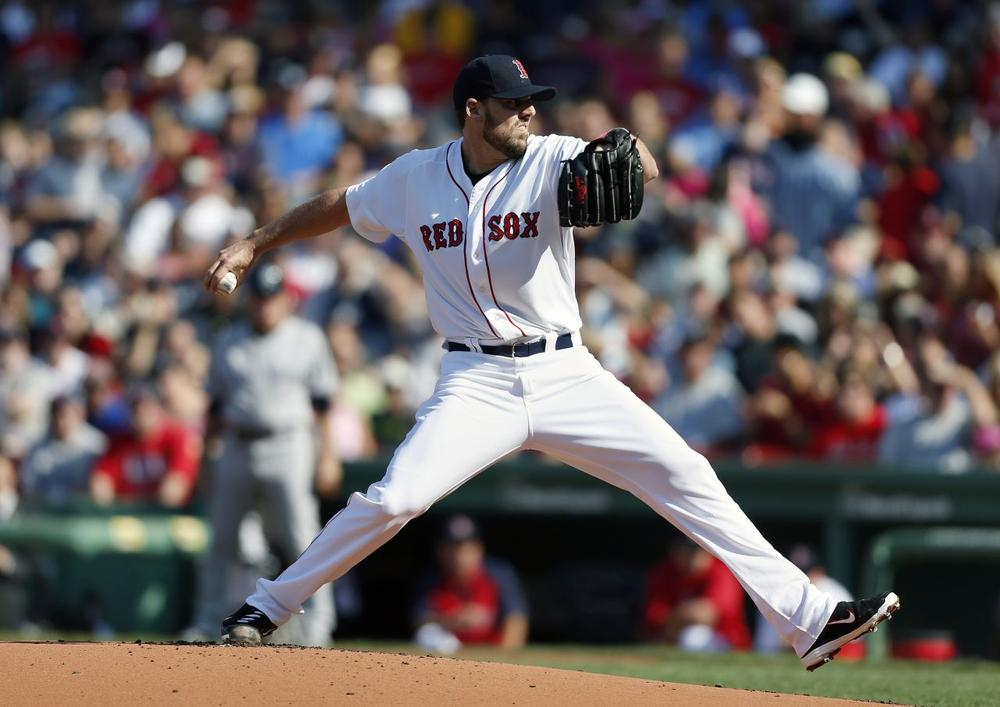 Red Sox's John Lackey pitches in the first inning of a baseball game against the New York Yankees in Boston, Saturday. (AP Photo/Michael Dwyer)