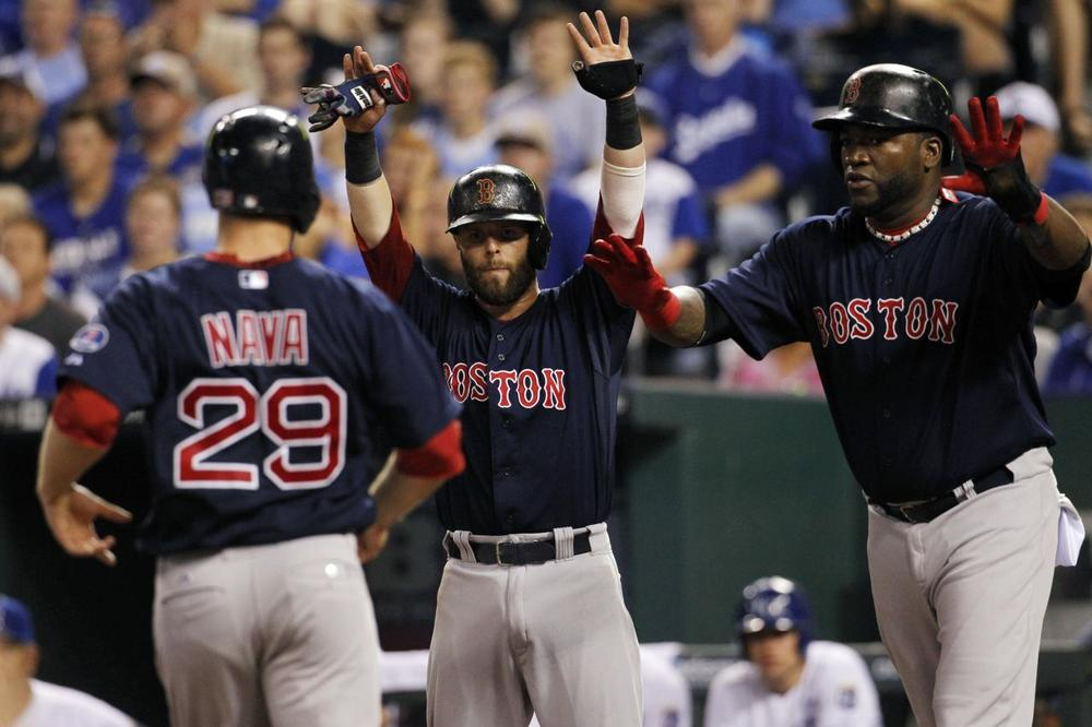 Red Sox's Daniel Nava is greeted at home plate by Dustin Pedroia and David Ortiz after all three scored on a Mike Napoli double in the fourth innin. (Colin E. Braley/AP)