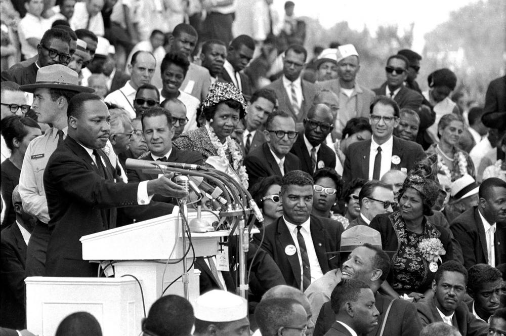 """In this Aug. 28, 1963 file photo, the Rev. Dr. Martin Luther King Jr., head of the Southern Christian Leadership Conference, speaks to thousands during his """"I Have a Dream"""" speech in front of the Lincoln Memorial for the March on Washington for Jobs and Freedom, in Washington. Actor-singer Sammy Davis Jr., is at bottom right. (AP)"""