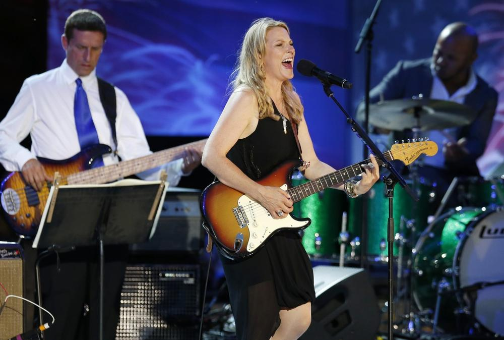 Susan Tedeschi performs during rehearsal for the Boston Pops Fourth of July concert at the Hatch Shell in Boston, Wednesday, July 3, 2013. (AP Photo/Michael Dwyer)