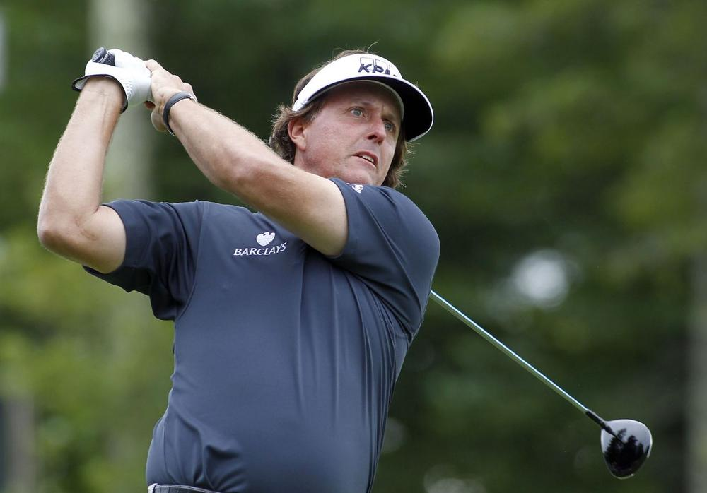 Phil Mickelson hits his tee shot on the 12th hole during the first round of the Deutsche Bank Championship golf tournament in Norton, Mass., Friday, Aug. 30, 2013. (Stew Milne/AP)