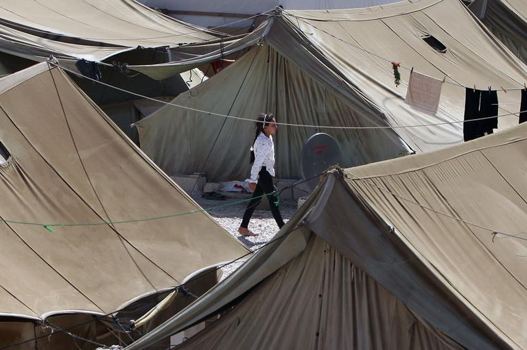 A Syrian refugee girl walks at a temporary refugee camp in the eastern Lebanese town of Marj near the border with Syria, Lebanon, Wednesday, Aug. 28, 2013. (AP)