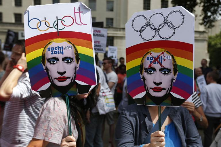 Activists holding placards depicting Russian President Vladimir Putin, participate at a protest against Russia's new law on gays, in central London, Saturday, Aug. 10, 2013. (AP)