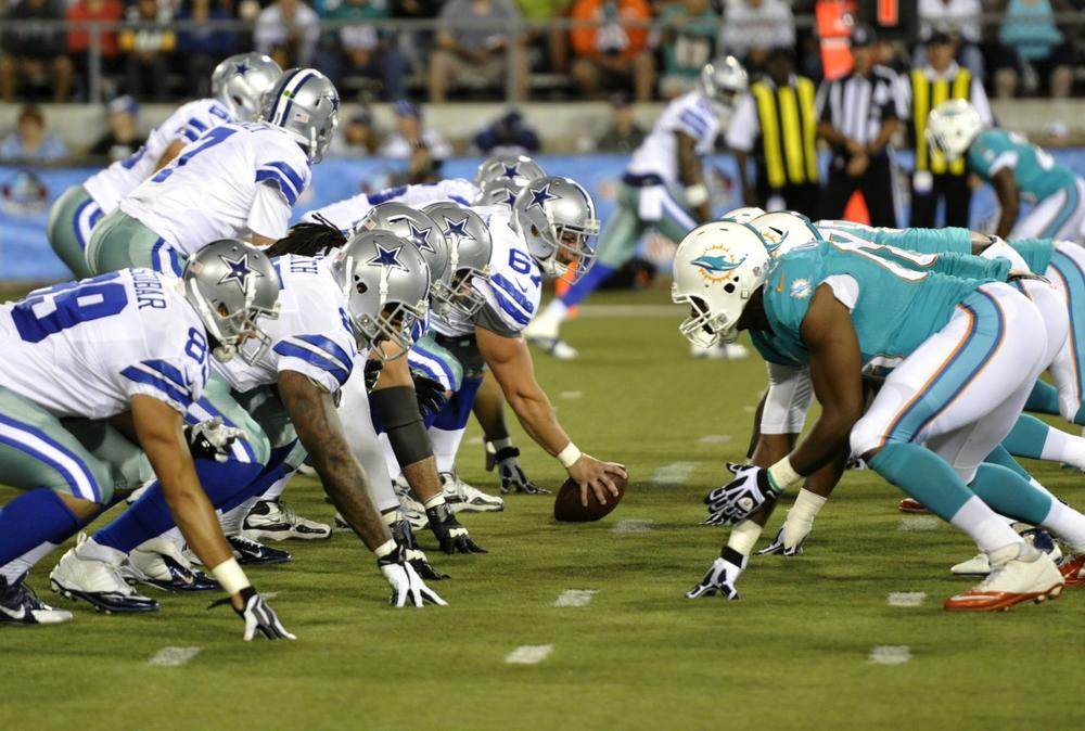 The Dallas Cowboys and the Miami Dolphins line up in the fourth quarter at the Pro Football Hall of Fame exhibition football game Sunday, Aug. 4, 2013, in Canton, Ohio. (AP Photo/David Richard)