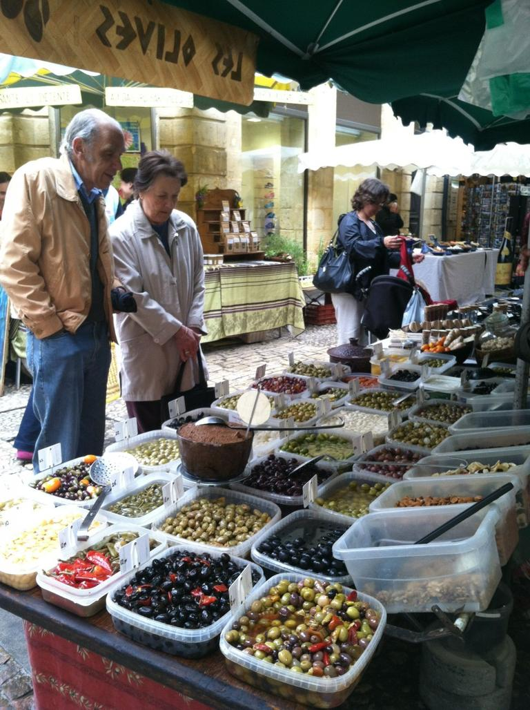 Olives,tapenade and sundried tomato paste at market in Sarlat, France (courtesy of author)