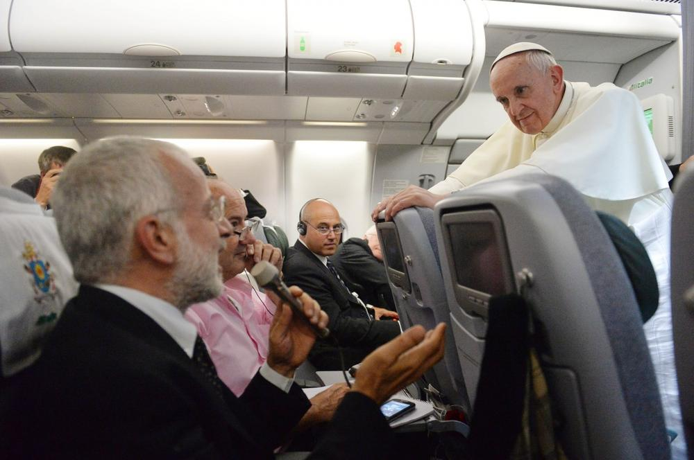 Pope Francis said he would not judge priests for their sexual orientation in a remarkably open and wide-ranging news conference Monday as he returned from his first foreign trip. (AP/Luca Zennaro)
