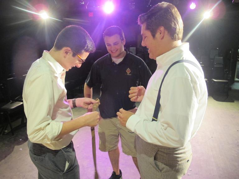From left: Serio, managing director Ritchie Sullivan and actor Angelo Denofrio (Andrea Shea/WBUR)