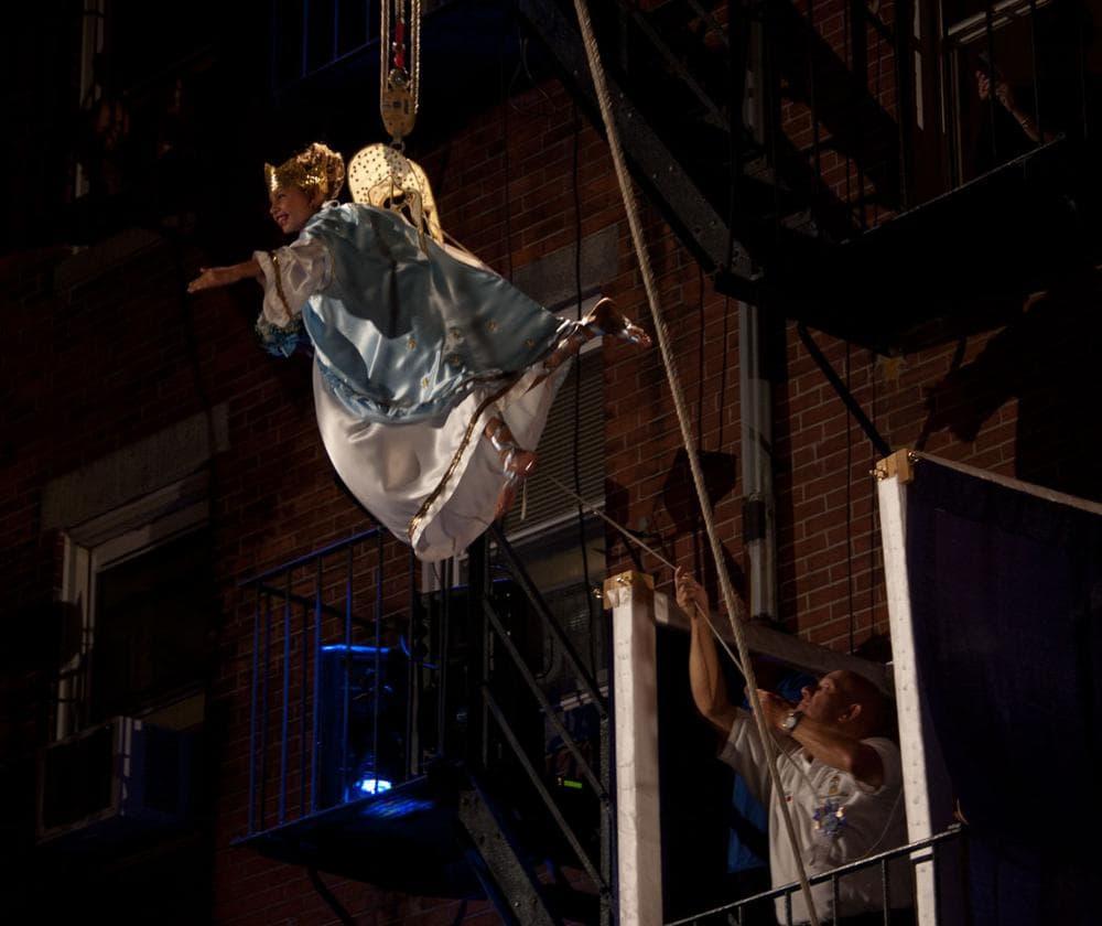 Victoria Bono flies over North Street. (Greg Cook/WBUR)