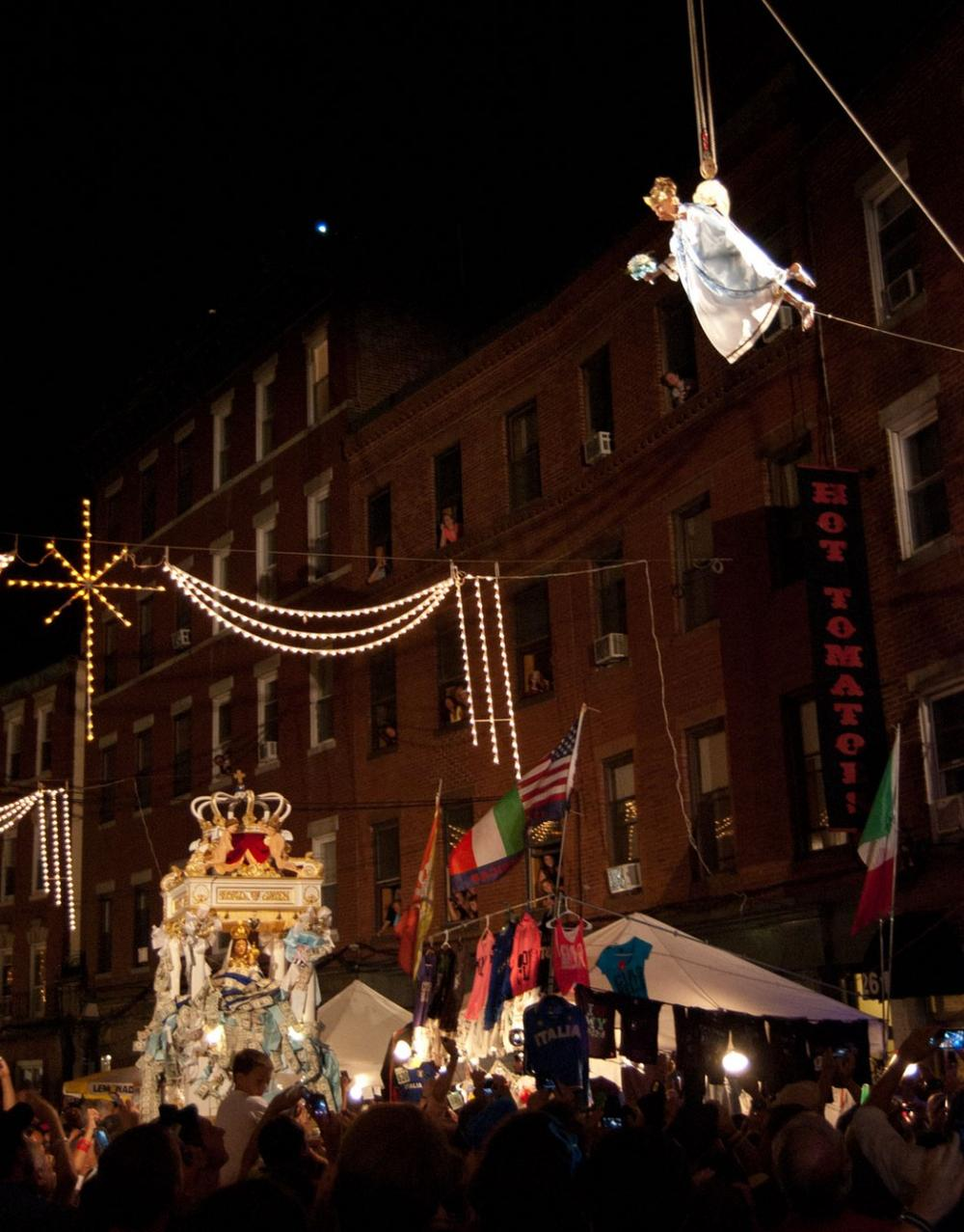 Hundreds watch as Victoria Bono flies over North Street. (Greg Cook/WBUR)