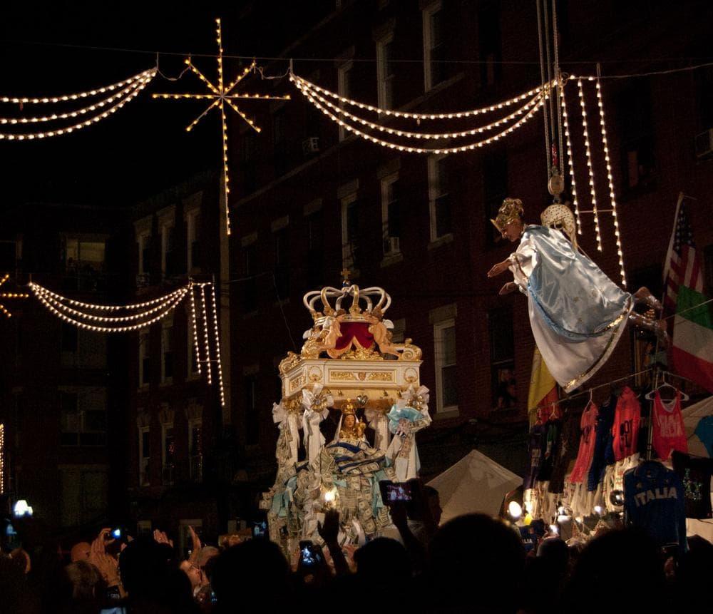 Flying angel Victoria Bono descends toward the statue of the Madonna Del Soccorso di Sciacca. (Greg Cook/WBUR)
