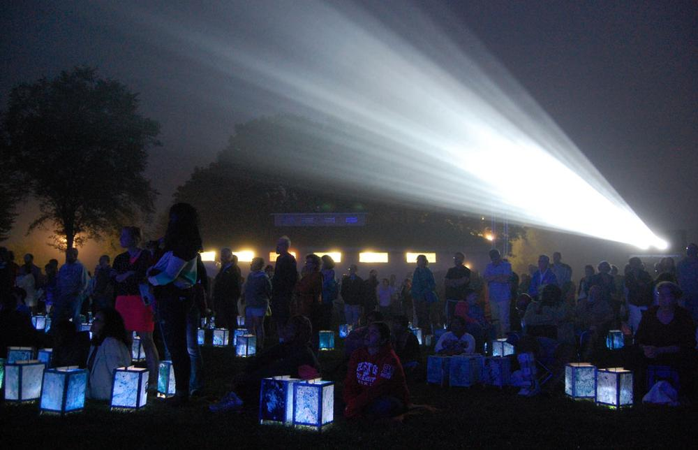 "Hundreds gathered on the lawn of South Boston's Castle Island Park in August 2013 for a screening and lantern walk organized by Medicine Wheel to mark the 50th anniversary of Martin Luther King Jr. delivering his ""I Have a Dream"" speech. (Greg Cook)"