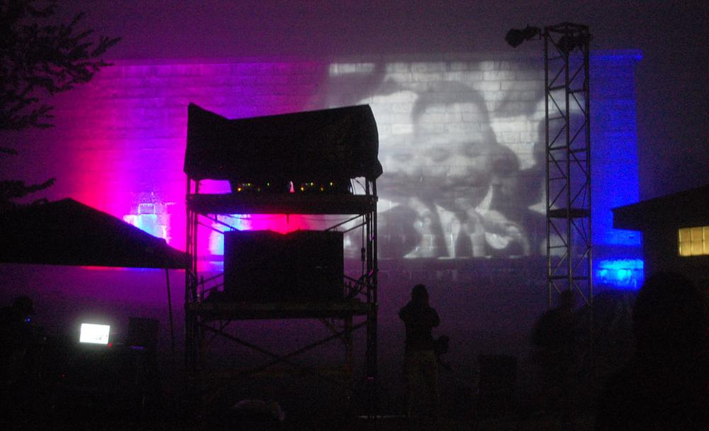 "Footage of King delivering his ""I Have a Dream"" speech is projected onto Fort Independence's wall. (Greg Cook)"