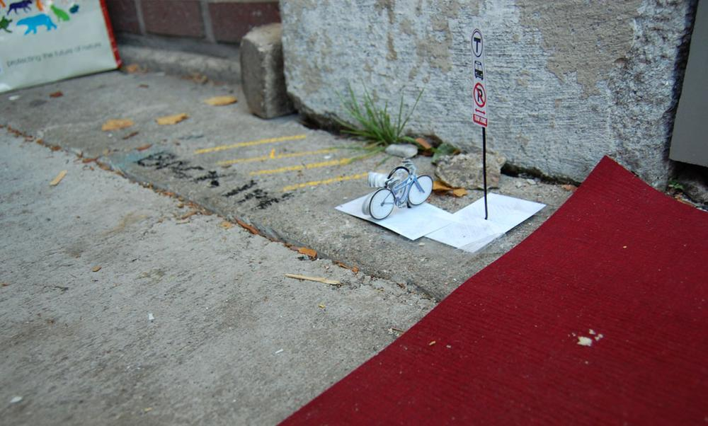 The petite angled parking, micro bike rack and micro bus stop temporarily installed next the red carpet laid out for the Mµseum's ribbon cutting. (Greg Cook/WBUR)