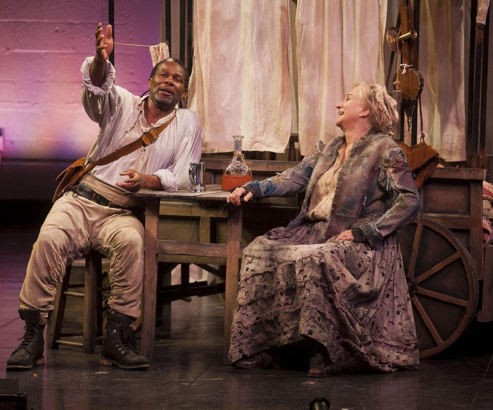 John Douglas Thompson as the cook and Olympia Dukakis as Mother Courage catch up during a brief outbreak of peace. (Courtesy photo)