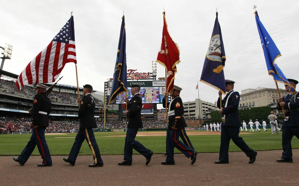 Members of the armed forces arrive for the national anthem before the baseball game between the Detroit Tigers and the Pittsburgh Pirates in Detroit, May 27, 2013. (Carlos Osorio/AP)