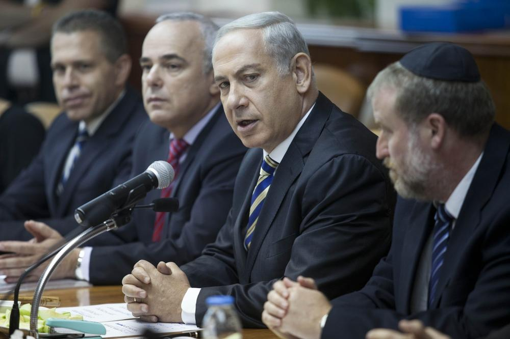 Israeli Prime Minister Benjamin Netanyahu, second right, chairs the weekly cabinet meeting in Jerusalem, Israel, Sunday, September 1, 2013. (Abir Sultan/AP)