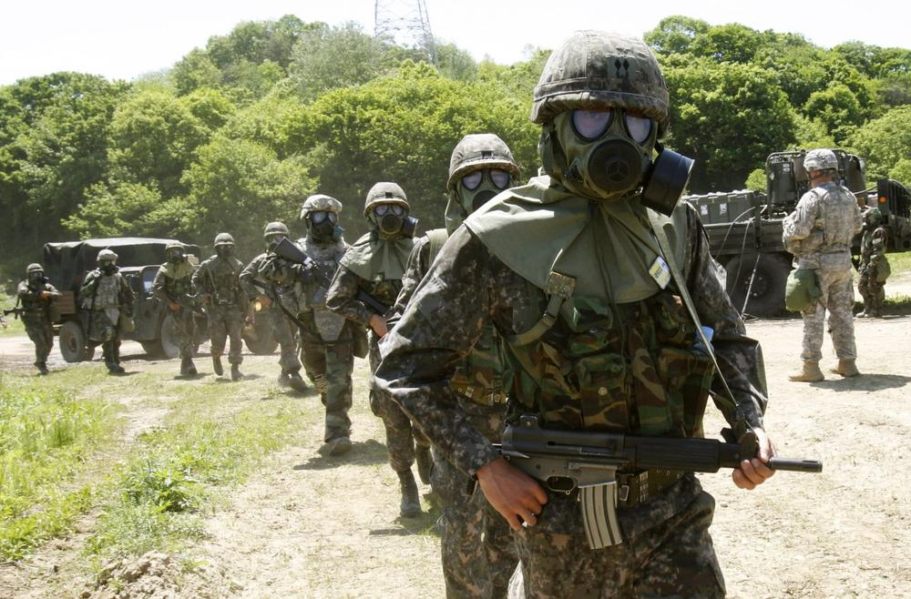 U.S. and South Korean Army soldiers participate in a CBR (chemical, biological and radiological) warfare training exercise in South Korea, May 16, 2013. (Ahnn Young-joon/AP)