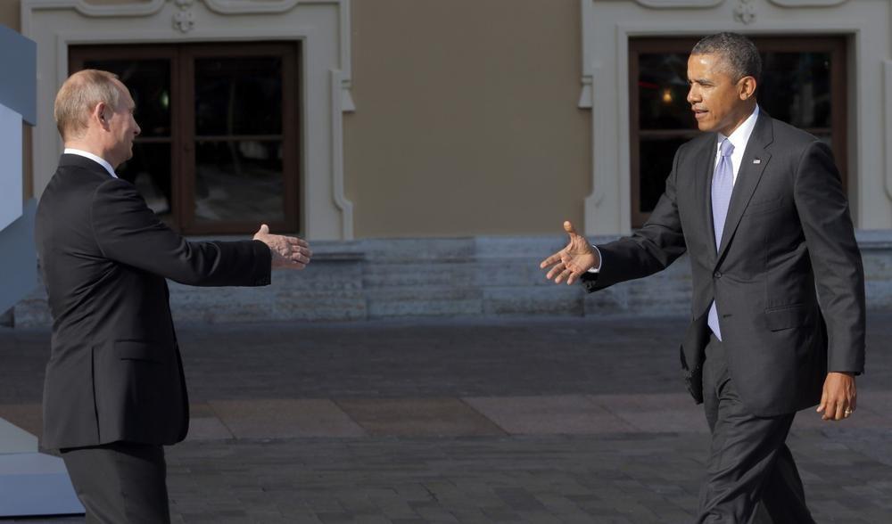Russia's President Vladimir Putin, left, reaches out to shake hands with U.S. President Barack Obama during arrivals for the G-20 summit at the Konstantin Palace in St. Petersburg, Russia on Thursday, Sept. 5, 2013. (Dmitry Lovetsky/AP)