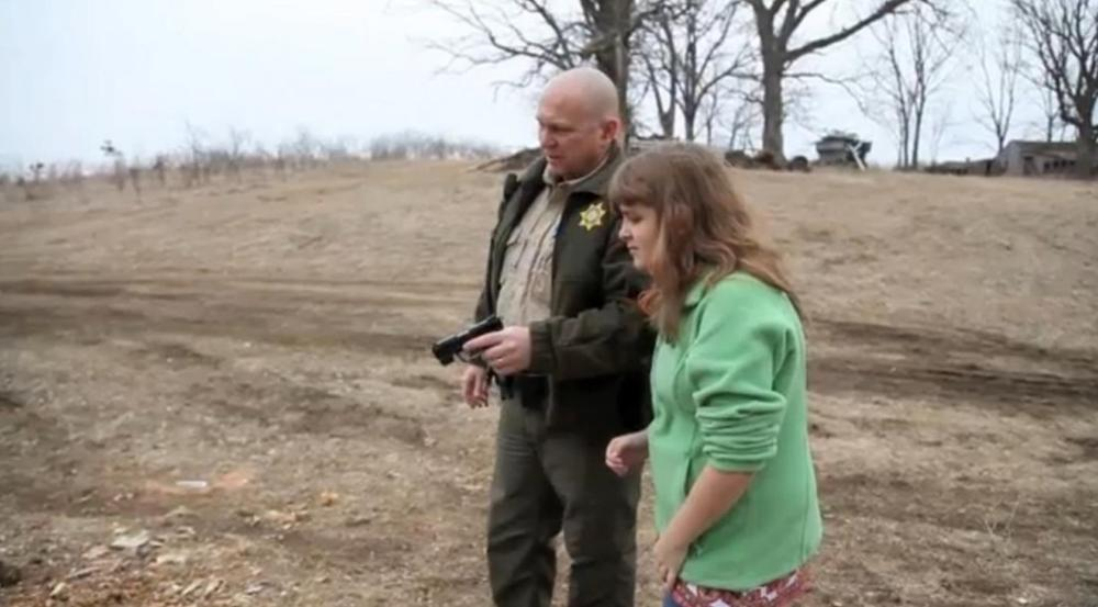 Sheriff Warren Wethington shows his visually impaired daughter how to shoot a firearm. (Screenshot from the Des Moines Register video)