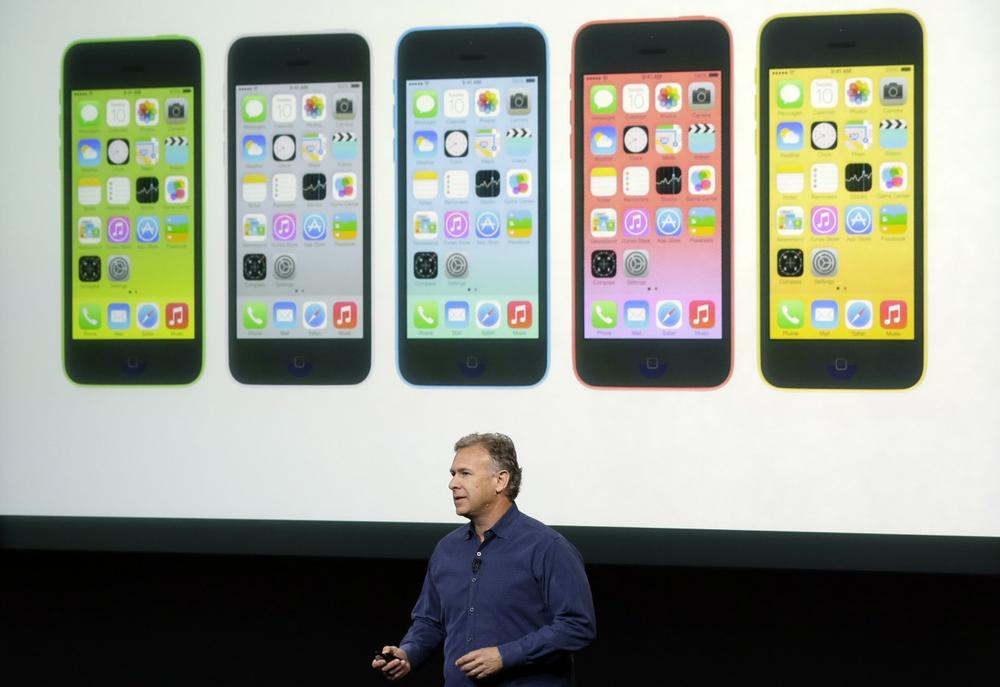 Phil Schiller, Apple's senior vice president of worldwide product marketing, speaks on stage during the introduction of the new iPhone 5c in Cupertino, Calif., Tuesday, Sept. 10, 2013. (Marcio Jose Sanchez/AP)