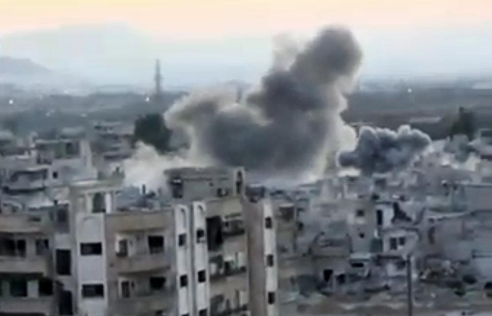 In this image taken from video obtained from the Shaam News Network, which has been authenticated based on its contents and other AP reporting, smoke rises from buildings due to heavy artillery shelling in Barzeh, a district of Damascus, Syria, Tuesday, Sept. 10, 2013. (Shaam News Network via AP video)