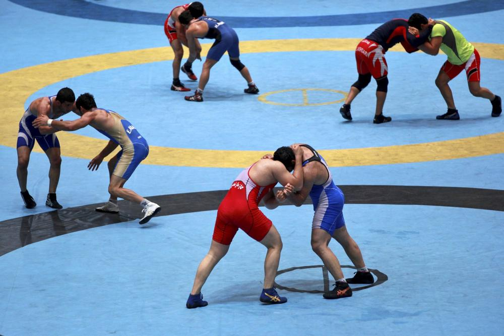 The IOC has reinstated wrestling to the Olympics, which will be hosted by Tokyo in 2020. (Ebrahim Noroozi/AP)
