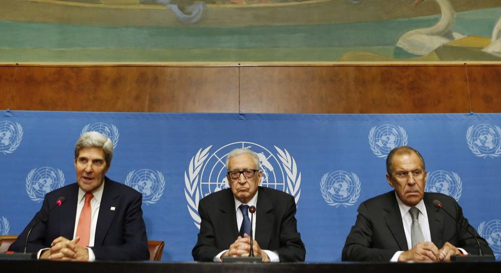 U.S. Secretary of State John Kerry, left, U.N. Special Representative Lakhdar Brahimi, center, and Russian Foreign Minister Sergei Lavrov deliver a statement to the media after a meeting discussing Syria at the United Nations offices in Geneva, Switzerland, Friday, Sept. 13, 2013. (Larry Downing/AP)