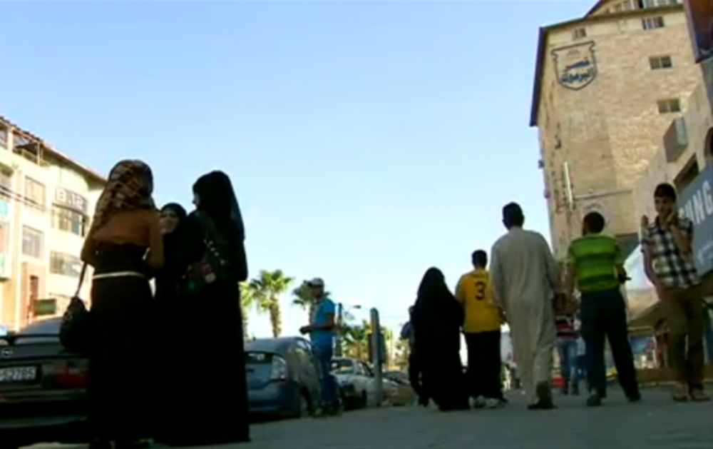 The BBC's Yolande Knell reports that one in three people in Irbid, Jordan, is Syrian — a result of an influx of refugees. (Screenshot from BBC video)