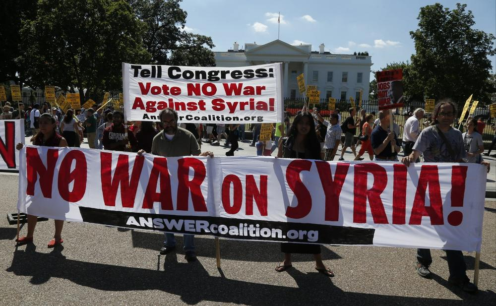 Anti-war demonstrators protest against possible U.S. military action in Syria in front of the White House in Washington, Saturday, Sept. 7, 2013. (Charles Dharapak/AP)
