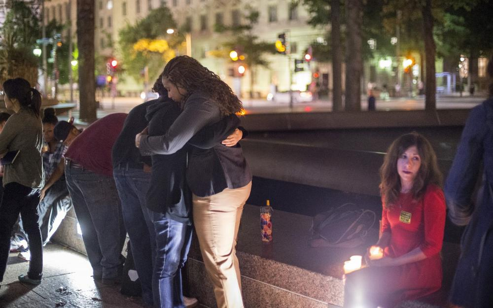 A small group holds a candle light vigil on Freedom Plaza to remember the victims of the shooting at the Washington Navy Yard, Monday, Sept. 16, 2013, in Washington. (J. Scott Applewhite/AP)