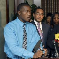 Willie Ferrell, left, talks about his relationship with his older brother, Jonathan Ferrell, at a media conference, as attorney Christopher Chestnut, center, his mother, Georgia Ferrell, right, listen on Monday, Sept. 16, 2013, in Charlotte, N.C. Police were called Sept. 14, after the former Florida A&M University football player knocked on the door of a home near the car crash he was in. Ferrell was hit with a Taser as he approached officers and then shot, resulting in a voluntary manslaughter charge against one of the officers. (Bob Leverone/AP)