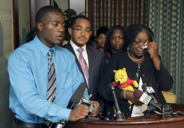 Willie Ferrell, left, talks about his relationship with his older brother, Jonathan Ferrell, at a media conference, as attorney Christopher Chestnut, center, his mother, Georgia Ferrell, right, listen on Monday, Sept. 16, 2013, in Charlotte, N.C. Jonathan Ferrell was shot in an officer involved shooting. (Bob Leverone/AP)