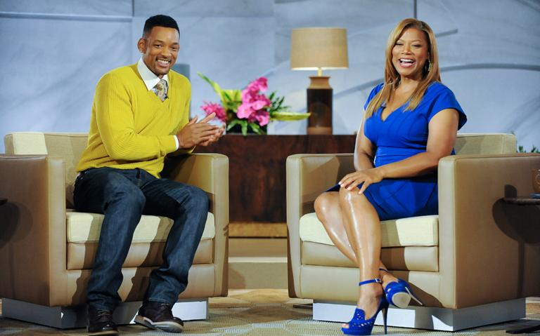 """Queen Latifah speaks with Will Smith on a recent episode of her new talk show, """"The Queen Latifah Show."""" (The Queen Latifah Show)"""