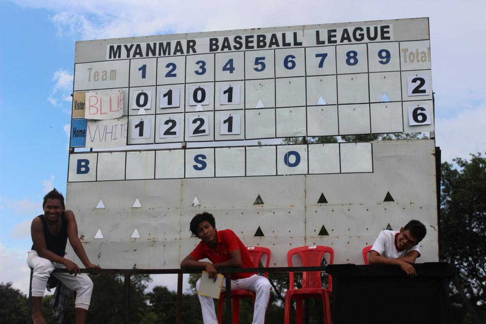 A manual scoreboard sits beside the field where the Myanmar national baseball team plays most of its games. The team has trouble finding local opponents. (David Grunebaum/Only A Game)
