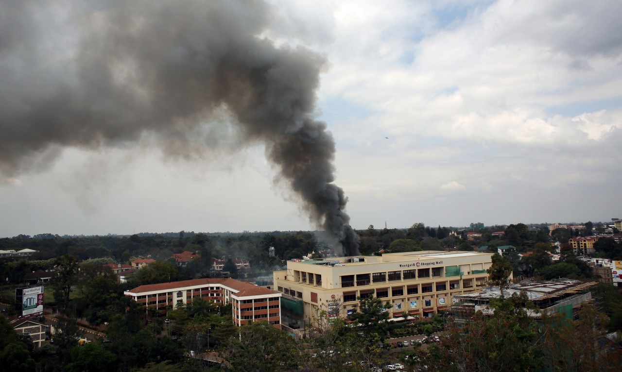 Heavy smoke rises from the Westgate Mall in Nairobi Kenya Monday Sept. 23 2013. (Jerome Delay/AP)