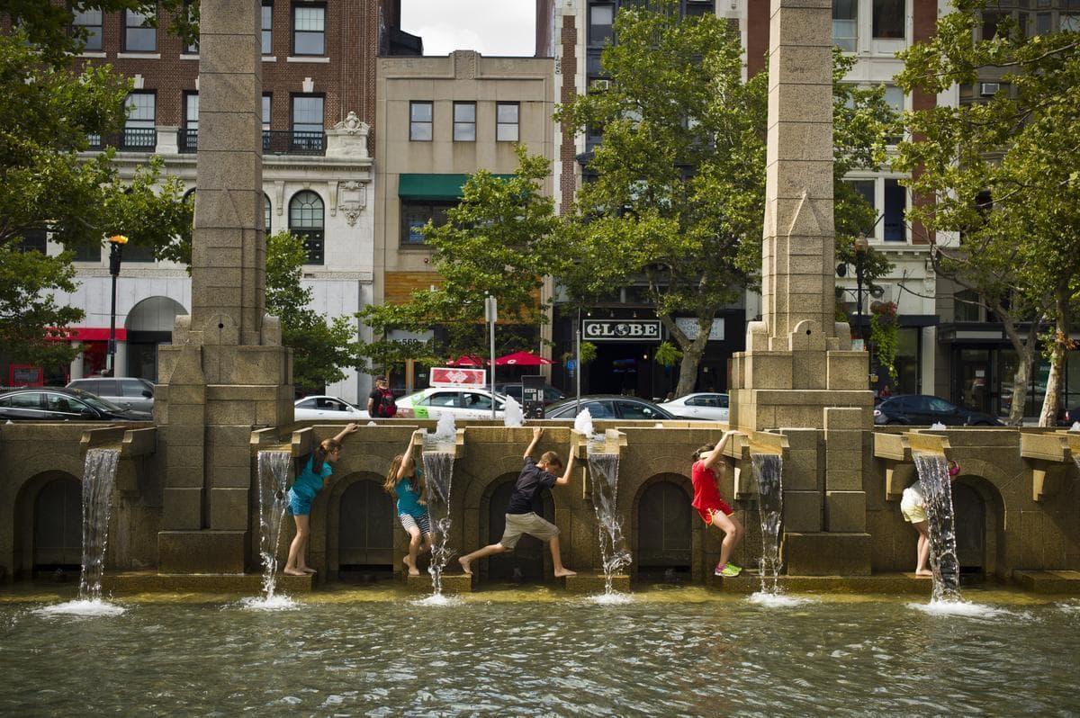 Children climb across the Copley Square fountain. (Dominick Reuter for WBUR)