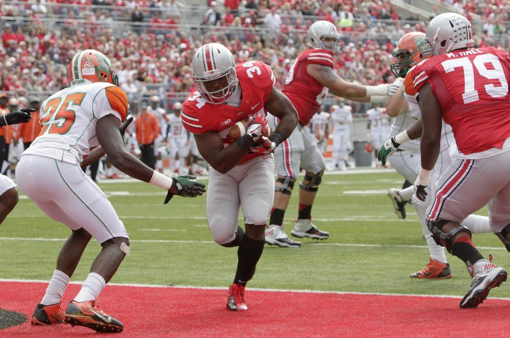 Ohio State running back Carlos Hyde (center) scores one of the team's 11 touchdowns against Florida A&M. (Jay LaPrete/AP)