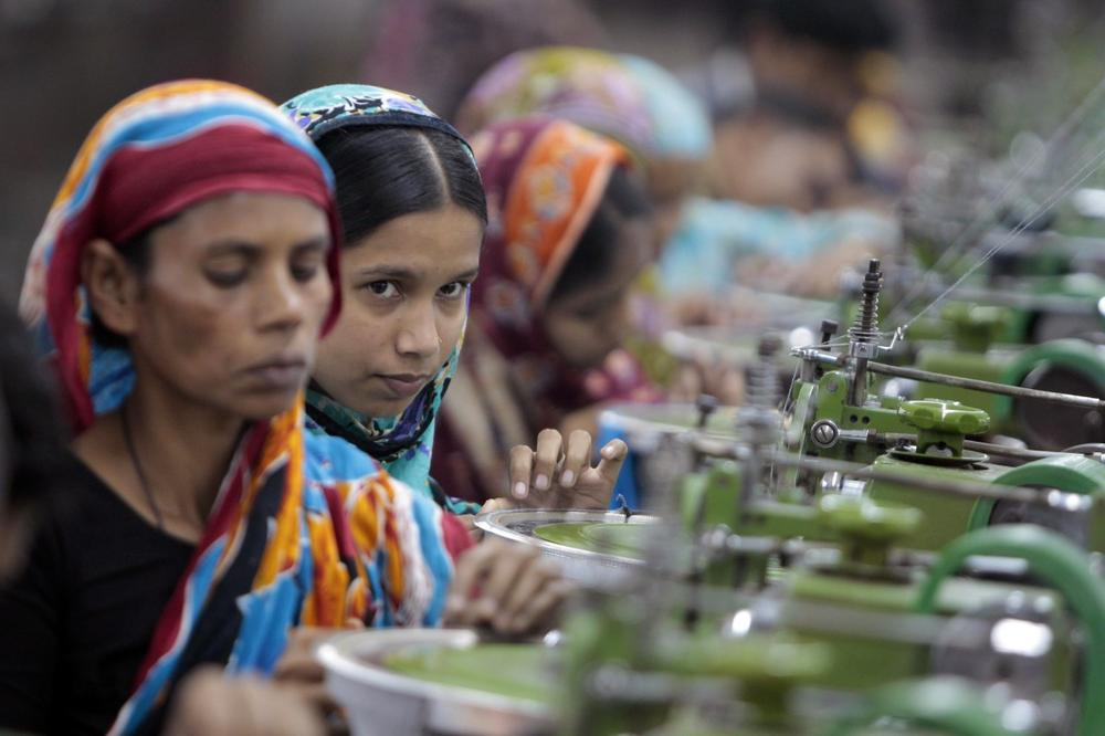 In this Saturday, Dec. 8, 2012, photo, Bangladeshi garment workers manufacture clothing in a factory on the outskirts of Dhaka, Bangladesh. (A.M. Ahad/AP)