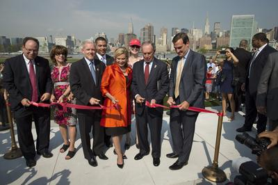 New York City Mayor Michael Bloomberg cuts a ribbon to officially open the new Hunter's Point South Waterfront Park, Wednesday, Aug. 28, 2013, in the Queens borough of New York. (AP)