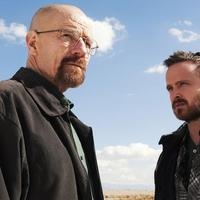 """This image released by AMC shows Bryan Cranston as Walter White, left, and Aaron Paul as Jesse Pinkman in a scene from """"Breaking Bad.""""  (AP Photo/AMC, Frank Ockenfels )"""