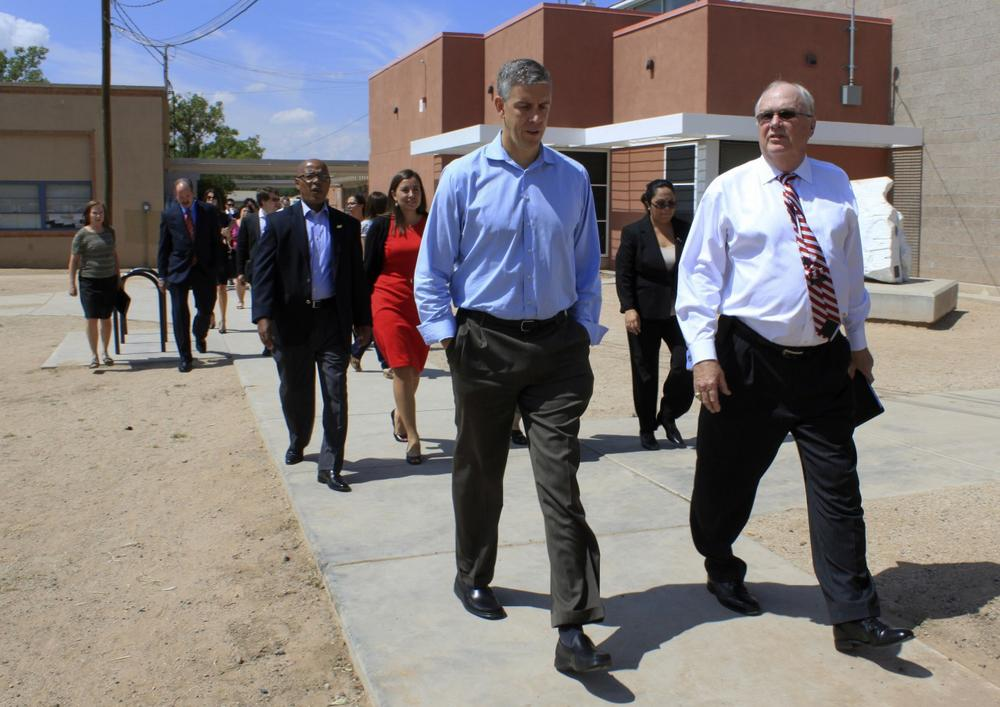 U.S. Secretary of Education Arne Duncan walks with Winston Brooks, Albuquerque Public Schools superintendent, during a tour of Emerson Elementary in Albuquerque, N.M., on Monday, Sept. 9, 2013. (AP)