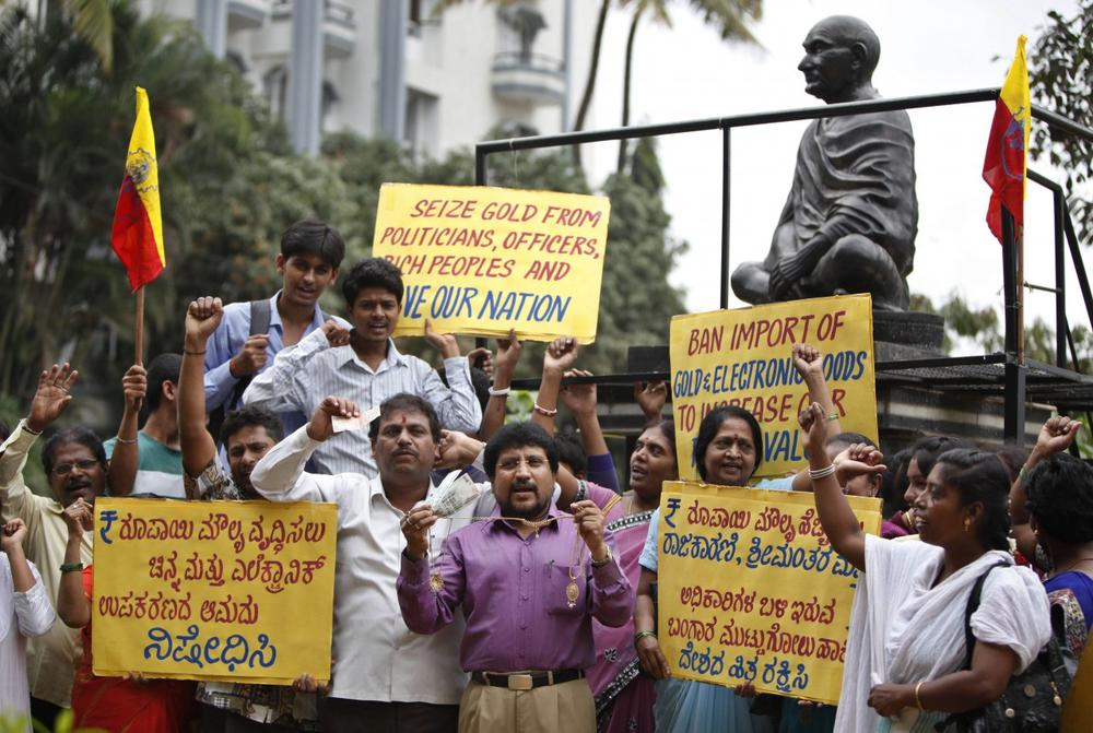 Indians protest asking the government to ban the import of gold, in Bangalore, India, Saturday, Sept. 7, 2013 as India's new central bank chief Raghuran Rajan announced measures to boost confidence as the troubled Indian economy slows and the currency tumbles. (AP)